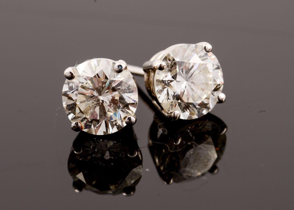Diamond Stud Earrings with Reflection